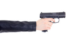 Gun in female hand isolated on white. Background Royalty Free Stock Photography