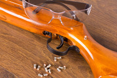 Gun, a few bullets and glasses Stock Photos