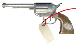 Gun With Fingerprint And Paper Tag Front. A regular metal revolver with a white fingerprint on the wooden handle and a paper tag connect to it with a zip tie on Stock Image