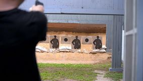 Gun fire target practice stock footage