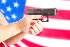 Gun with flag Royalty Free Stock Photography