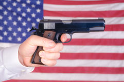 Gun, flag closeup Royalty Free Stock Images