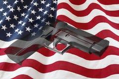 Gun and flag Royalty Free Stock Photos