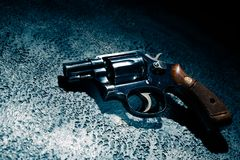 Gun on the floor, high contrast image Royalty Free Stock Image