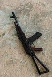 Gun on the floor Stock Photo