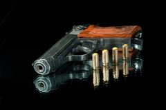 Gun with four bullet Royalty Free Stock Images