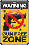 Gun Free Zone Sign with Bullet Holes. Vector Gun Free Zone street and building sign shot full of bullet holes Royalty Free Stock Photos