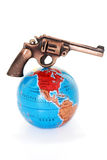 Gun on globe Royalty Free Stock Photo
