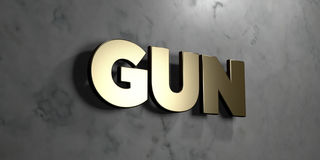 Gun - Gold sign mounted on glossy marble wall  - 3D rendered royalty free stock illustration Royalty Free Stock Images