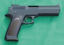 Gun on green Royalty Free Stock Photos
