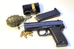 Gun, grenade  and bullets Stock Photography