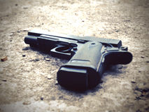 Gun on ground Stock Images