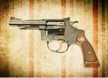Gun on grunge background Royalty Free Stock Photos