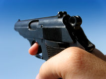 Gun in the hand Royalty Free Stock Photography