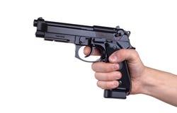 Gun in hand Stock Photo