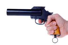 Gun in hand. Flare gun aimed cocked in right hand Stock Photo