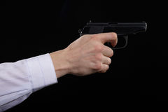 Gun in hand Stock Image