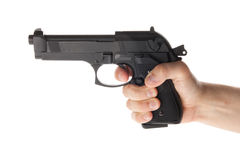 Gun in hand. A hand is holding a gun Royalty Free Stock Image