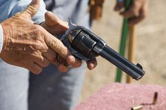 Gun in hand 4. Waiting to participate in the cowboy action shooting competition in Casa Grande Arizona Stock Image