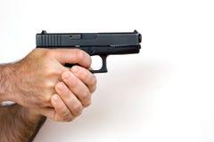 Gun in Hand Royalty Free Stock Image