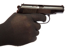 Gun in hand with black gloves. Stock Image