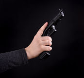 Gun in a hand Stock Photos