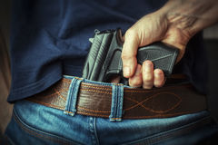 Gun in hand Royalty Free Stock Photography