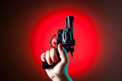 Gun in a hand. Macro view stock images