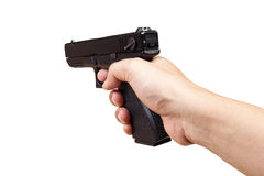 Gun in hand and pointing, isolated on white background Stock Images