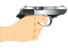 Gun in hand. Weapon gun in hand of the person on white background is insulated Stock Images