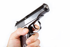 Gun in hand on a white. Stock Photo