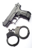 Gun with handcuffs Royalty Free Stock Photos