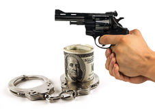 Gun handcuffs and dollars. the concept of crime, corruption, ju Stock Images