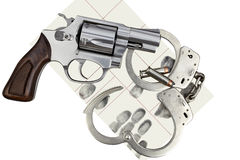Gun with handcuffs and fingerprint ID for criminal arrest Royalty Free Stock Photos