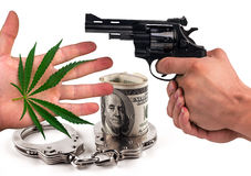 Gun, handcuffs, marijuana and dollars isolated. The concept of crime royalty free stock photography