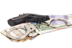 Gun, handcuffs and money Royalty Free Stock Photo