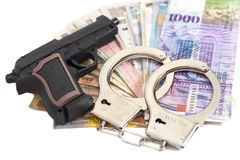 Gun, handcuffs and money Stock Photography