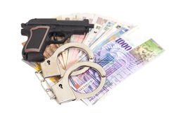 Gun, handcuffs and money Royalty Free Stock Photography