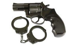 Gun and handcuffs Royalty Free Stock Photos