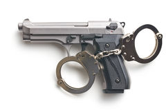 Gun and handcuffs Stock Images