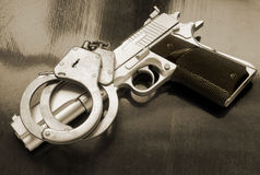 Gun and handcuffs Stock Photography