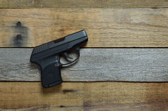 Gun, handgun, weapon, firearm. Gun handgun, weapon, firearm, single displayed on pallet wood royalty free stock images