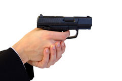 Gun in hands Royalty Free Stock Photography