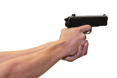 Gun in hands Stock Photo