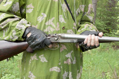 Gun in the hands of the arrow Royalty Free Stock Photos