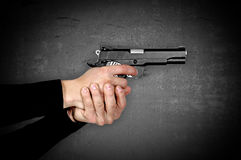 Gun in hands Royalty Free Stock Photo