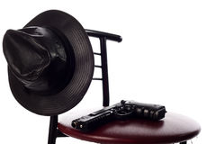 Gun and hat on the chair. Isolated on the white Stock Photo