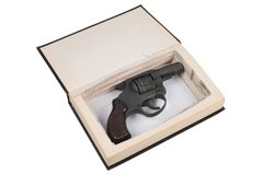 Gun hidden in a book Stock Photography