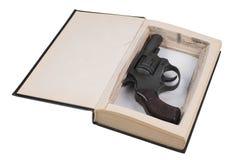 Gun hidden in a book Stock Photo