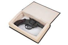 Gun hidden in a book Stock Images